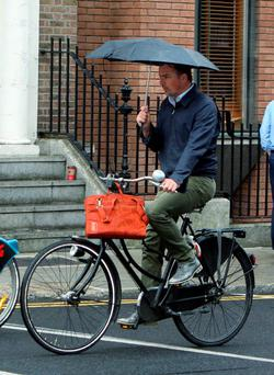 A cyclist braves the rain in Dublin city centre