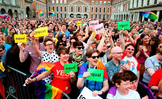 People gathered at Dublin Castle as the results of the same-sex marriage referendum were counted. Photo: PA