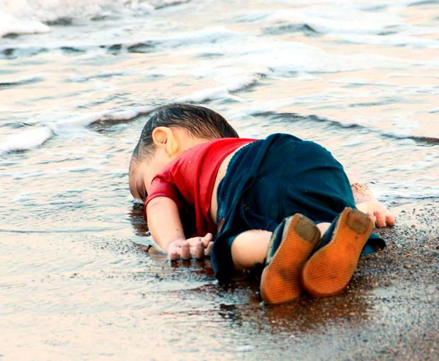 The body of little Aylan (3), who died along with his mother and five-year-old brother as they tried desperately to escape Syria for a new life in Europe, is washed up on the idyllic Turkish sands at Bodrum Photo: Reuters