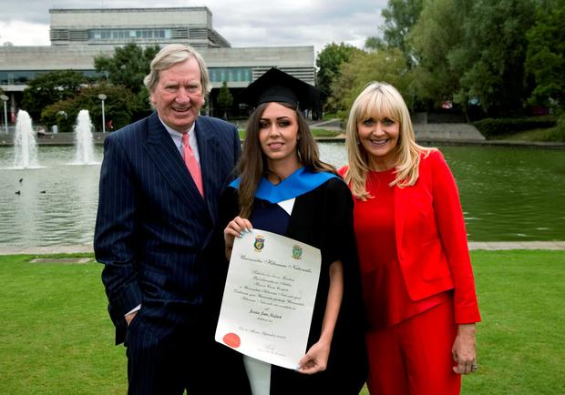 Jessica McGurk, who was conferred with a Honours Degree of Bachelor of Arts from UCD with her parents Tom McGurk and mother Miriam O' Callaghan. Picture: Colm Mahady/Fennells