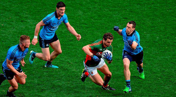 30 August 2015; Tom Parsons, Mayo, in action against Ciarn Kilkenny, Diarmuid Connolly, and Denis Bastick, Dublin. GAA Football All-Ireland Senior Championship, Semi-Final, Dublin v Mayo, Croke Park, Dublin. Picture credit: Dire Brennan / SPORTSFILE