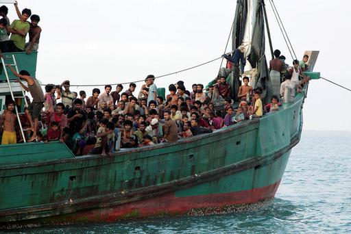 Rohingya and Bangleshi migrants off the coast of Indonesia Credit: Reuters