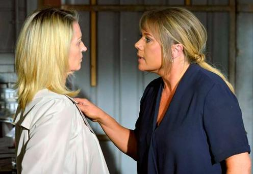 Kathy faces off with Sharon on EastEnders. PIC: BBC