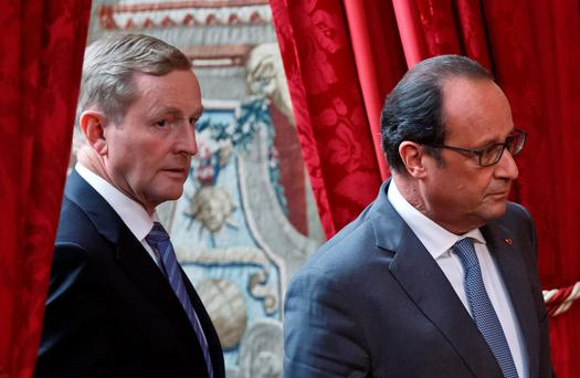 Irish Prime Minister Enda Kenny, left, and French President Francois Hollande, arrive for a joint media conference at the Elysee Palace in Paris, Thursday, Sept. 3, 2015. (AP Photo/Michel Euler)