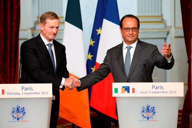 French President Francois Hollande (R) attends a joint news conference after a meeting with Ireland's Prime Minister Enda Kenny at the Elysee Palace in Paris, France, September 3, 2015. REUTERS/Benoit Tessier