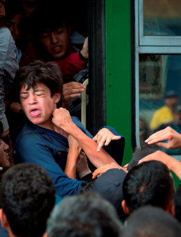 A crush as migrants board a train in Budapest – the refugee crisis is confronting us with questions every bit as hard, challenging and divisive as those raised by the economic crash