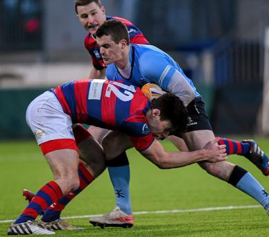 UCD's Stephen Murphy is tackled by Matt D'Arcy of Clontarf last January