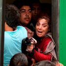 Refugees squeeze on to a train in Budapest, Hungary