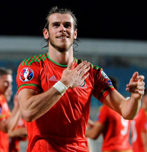 Wales' Gareth Bale celebrates his side's win after the UEFA European Championship Qualifying match at the GSP Stadium, Cyprus