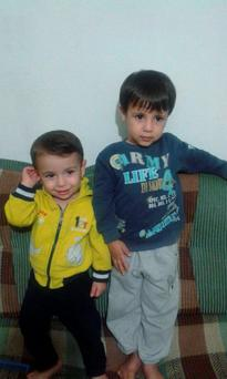 Aylan Kurdi and his older brother Galip