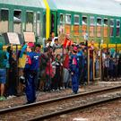 Migrants stage a protest in front of a train at Bicske railway station in Hungary Credit: REUTERS/Leonhard Foeger