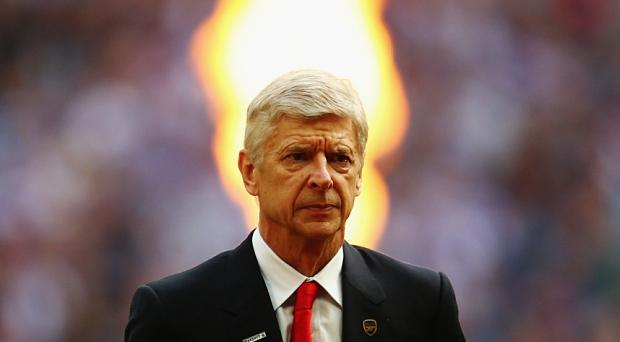 Arsene Wenger is 'cheating Arsenal fans' by not buying a striker, according to Paul Merson Photo: 2015 Getty Images