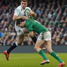 Ireland's fly half Johnny Sexton tackles England's fly half George Ford during the Six Nations earlier this year