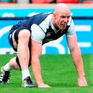 Irish captain Paul O'Connell goes through his stretching exercises during the captain's run at Twickenham yesterday ahead of today's World Cup warm-up clash with England