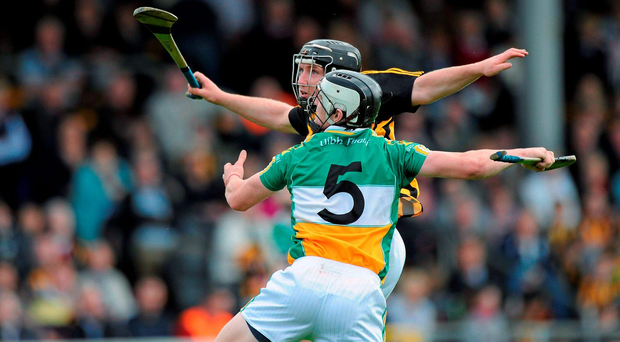 Michael Verney challenges Richie Hogan during Offaly's game against Kilkenny in 2011