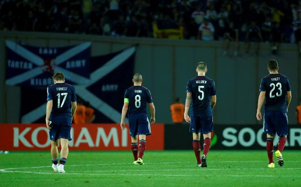 Scotland's James Forrest, Scott Brown, Charlie Mulgrew and Grant Hanley (L-R) leave the pitch after their defeat against Georgia at the Boris Paichadze Dinamo Arena stadium in Tbilisi