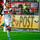 Mario Goetze celebrates after sealing victory for Germany