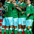 Shane Long, second left, celebrates with his teammates after scoring Ireland's fourth goal against Gibraltar in Faro last night