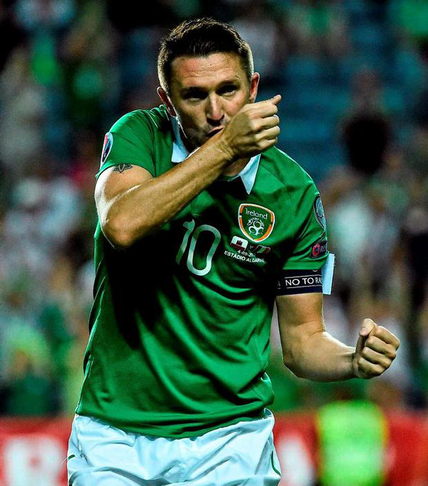 Irish captain Robbie Keane celebrates scoring his second goal in the 4-0 victory over Gibraltar in the Euro 2016 qualifier in Faro last night