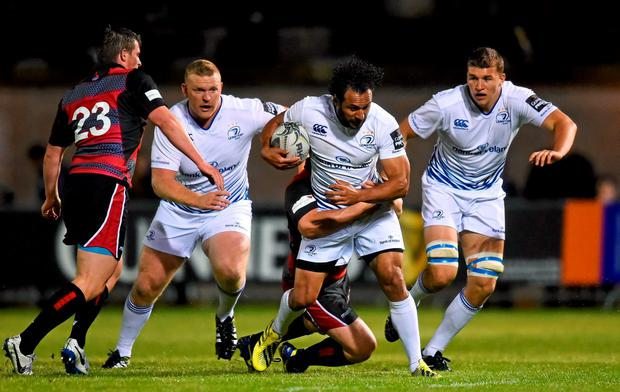 Leinster's Isa Nacewa is tackled by Neil Cochrane