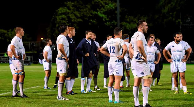 Leinster players following their side's defeat in Edinburgh