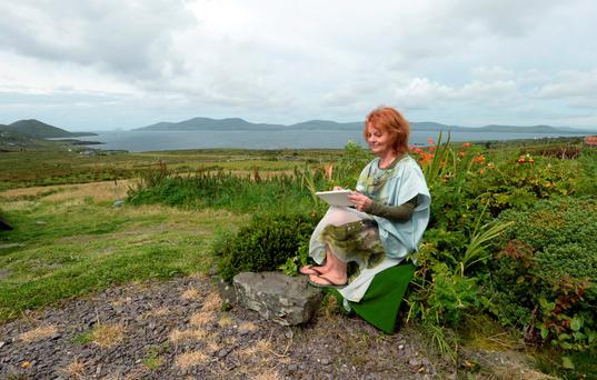 Just as it was instant love with her husband Paolo Tullio, Artist Susan Morley was smitten with Kerry where she now has a studio in Watterville. Photo: Don MacMonagle