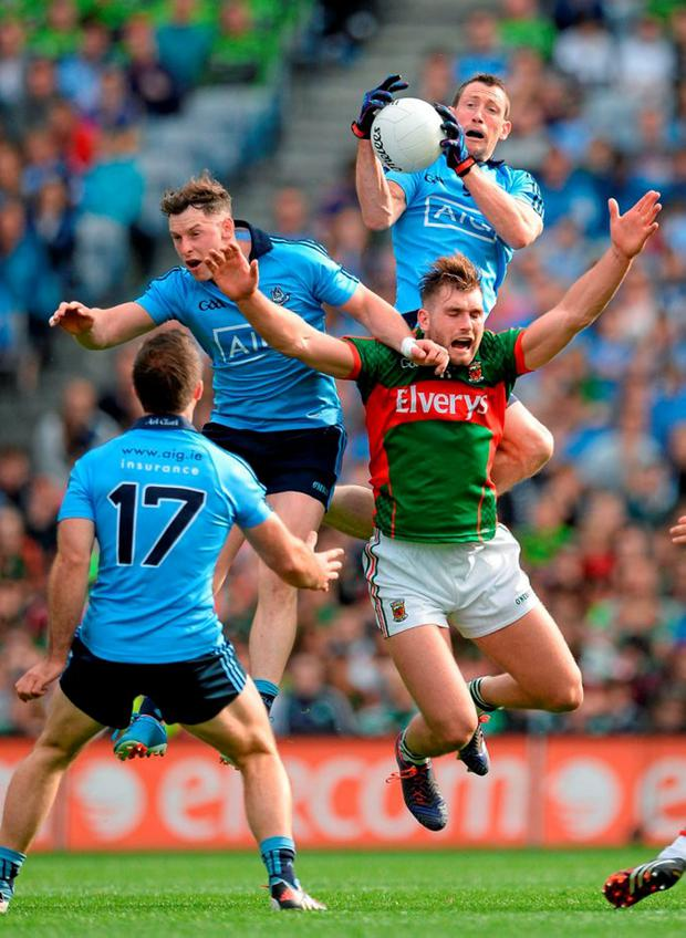 Dublin's Denis Bastick fields a kickout ahead of team-mate Philly McMahon and Mayo's Aidan O'Shea