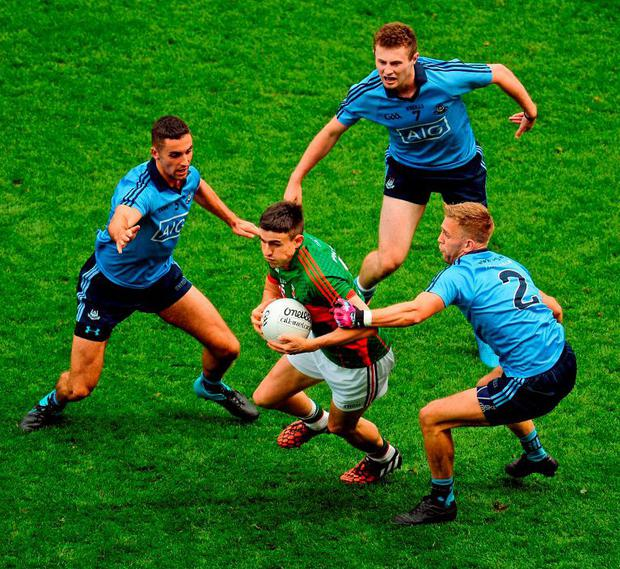 Mayo's Jason Doherty is quickly closed down Dublin players, left to right, James McCarthy, Jack McCaffrey, and Jonny Cooper