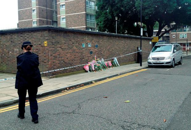 The scene close to St John's Estate in Hoxton, in east London as a murder investigation has been launched into the