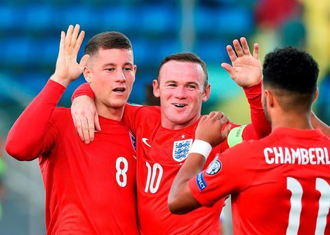 England's Ross Barkley (L) celebrates after scoring a goal with team mates Wayne Rooney (C) and Alex Oxlade-Chamberlain during their Euro 2016 qualifying soccer match against San Marino at the Olympic stadium in Serravalle, San Marino September 5, 2015. REUTERS/Alberto Lingria