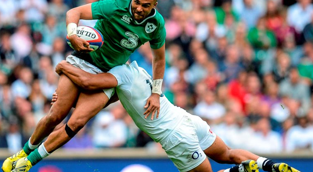 Simon Zebo is tackled by Jonathan Joseph at Twickenham yesterday