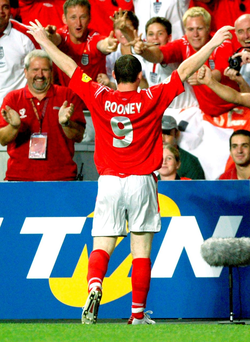 Wayne Rooney celebrates in front of England fans