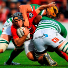 Munster's Duncan Williams tries to find a way past Duncan Naudé and Tom Palmer