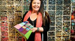 Material girl: Maeve Patterson with her button collection in her shop, Studio 54