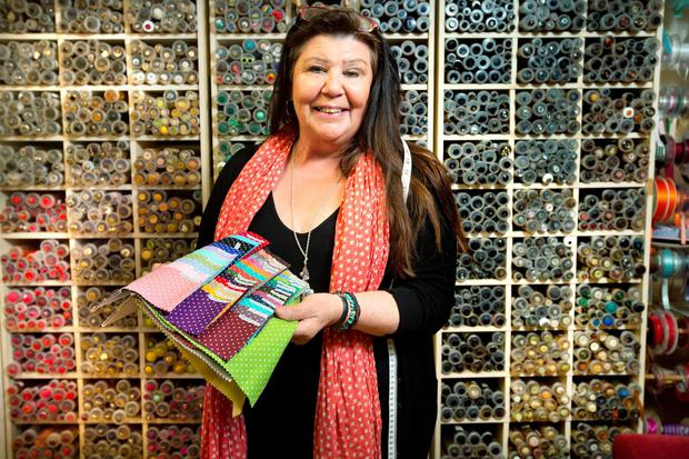 57609194370 Material girl  Maeve Patterson with her button collection in her shop