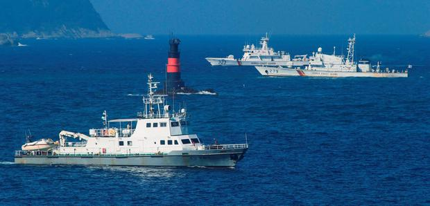 South Korean Coast Guard ships sail to search for missing passengers who were on a capsized fishing boat in the water off north of the resort island of Jeju, South Korea, Sunday, Sept. 6, 2015. (Park Ji-ho/Yonhap via AP)