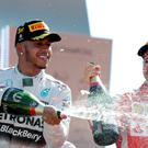 Mercedes Formula One driver Lewis Hamilton (L) of Britain celebrates his victory in the Italian F1 Grand Prix in Monza. REUTERS/Max Rossi