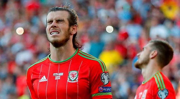 Wales' Aaron Ramsey and Gareth Bale look dejected after Bale took a freekick Action Images via Reuters / Andrew Boyers