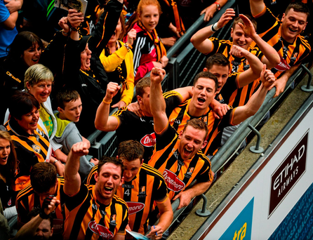 Kilkenny players celebrate as team captain Joey Holden lifts the Liam MacCarthy cup