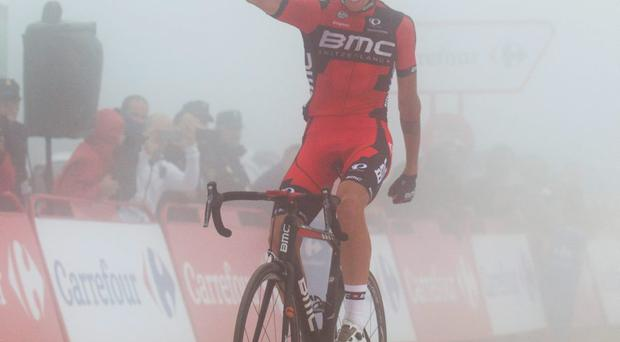 Italian cyclist Alessandro de Marchi celebrates in the mist after winning the 14th stage of the Vuelta on Saturday