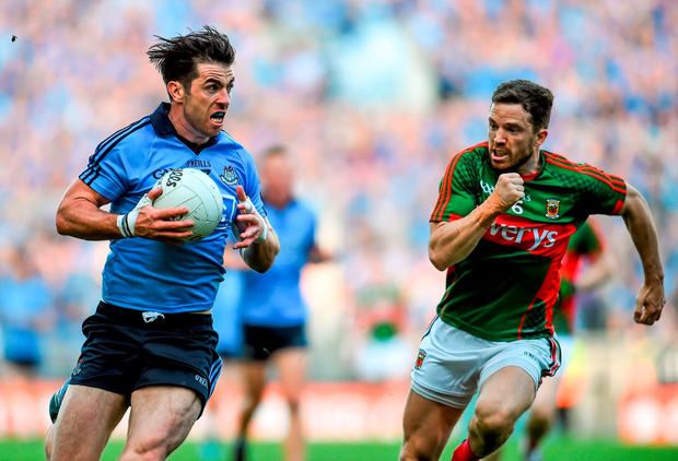 Dublin's Michael Darragh MacAuley gets away from Chris Barrett of Mayo
