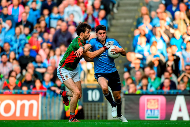 Dublin's Bernard Brogan takes on Mayo's Ger Cafferkey during the All-Ireland SFC semi-final replay at Croke Park