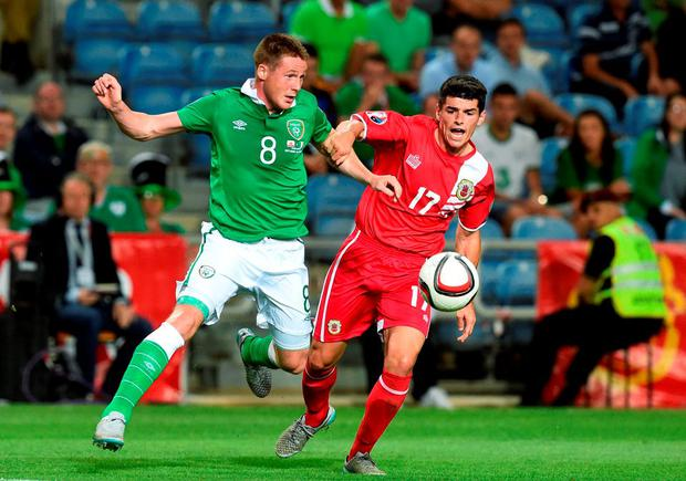The Republic of Ireland's James McCarthy vies with Gibraltar's Anthony Bardon during their Euro 2016 qualifier at the Algarve Stadium in Faro
