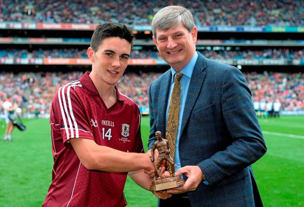 Evan Niland, Galway, is presented with the Player of the Match award by Pat O'Doherty, Chief Executive, ESB