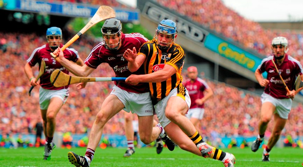 Galway's Pádraig Mannion goes shoulder to shoulder with Kilkenny's Ger Aylward during yesterday's All-Ireland SHC final at Croke Park