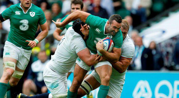Ireland's Dave Kearney and England's Chris Robshaw and Ben Morgan during the World Cup Warm up match at Twickenham Stadium, London