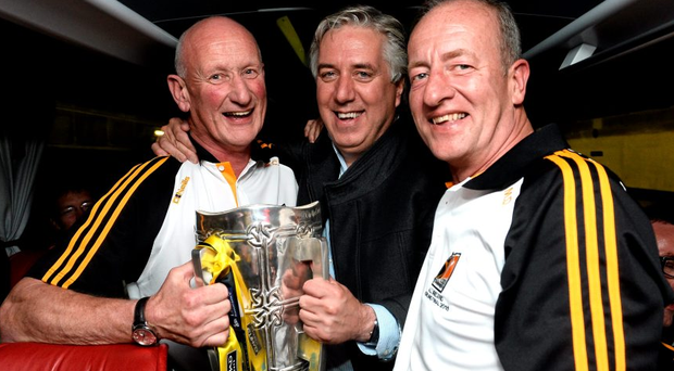 Kilkenny manager Brian Cody, left, and selector Michael Dempsey celebrate with FAI Chief Executive John Delaney on the team bus