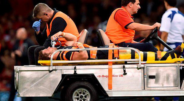 Wales' Leigh Halfpenny leaves the field on a stretcher during the World Cup Warm up match at the Millennium Stadium, Cardiff
