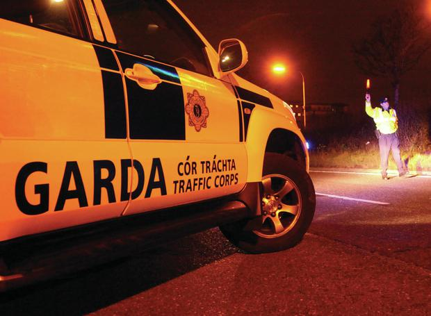 Two gardai injured after their patrol car rammed at checkpoint