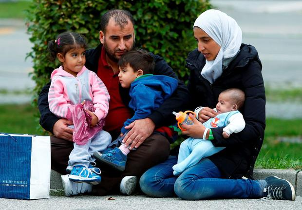 A migrant family from Syria is seen outside a refugee camp at the fair ground of Munich, Germany September 7, 2015. Reuters/Michaela Rehle